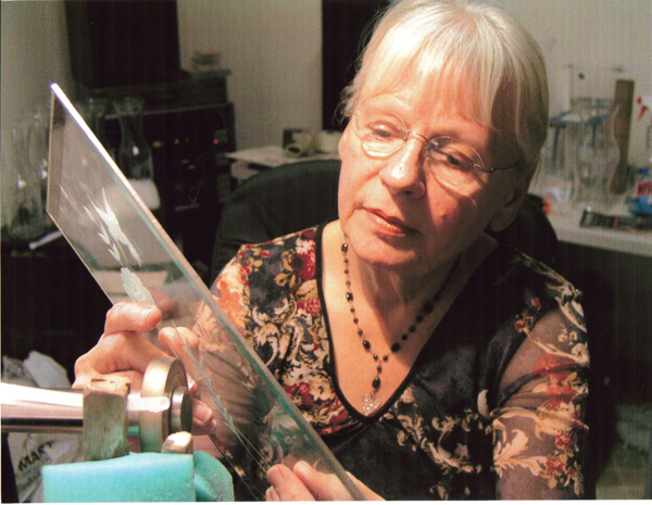 Patty Sevre cutting glass