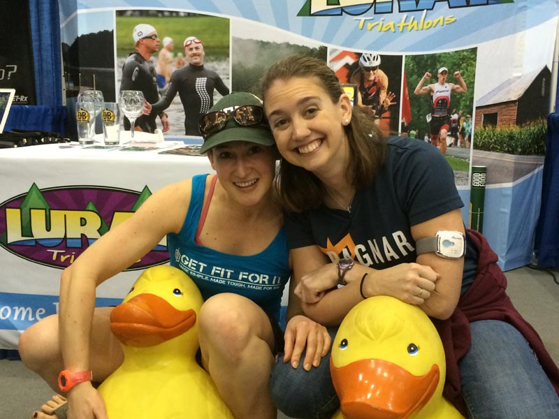 women on ducks at luray triathlon expo booth